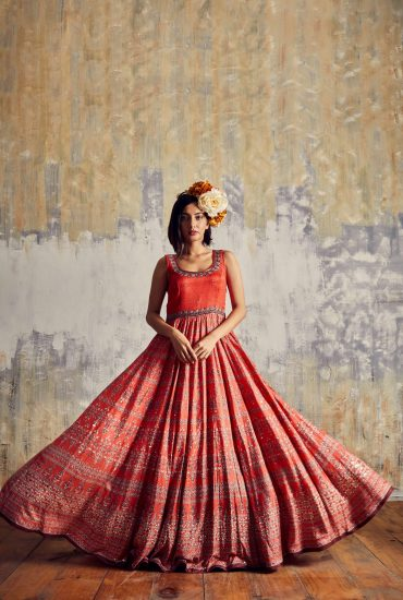 Up to the minute red Tussar long dress with intricate print & beautiful hand embroidered neck line & organza scarf