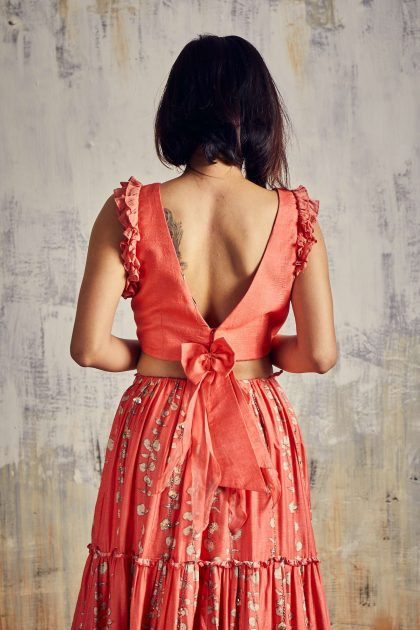 Coral red Tiered Tussar skirt with trendy crop top, all delicately hand embroidered teamed with ruffled scarf