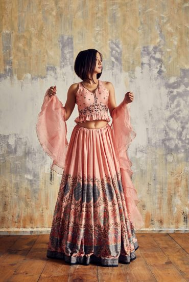 Elegant rose pink lehenga in Tussar & trendy crop top with delicate hand work and spiral organza dupatta