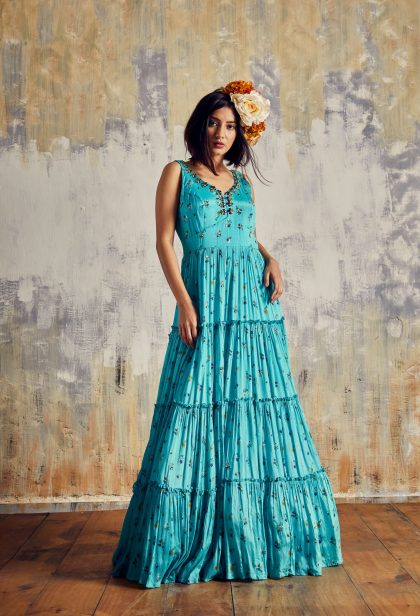 Aqua blue chiffon long dress with tiny Floral Print and beautiful stone work neck line. This Contemporary dress is a style statement on its own