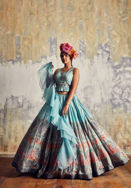 Soft Aqua printed lehenga in Tussar & trendy crop top in delicate hand work along with spiral organza dupatta