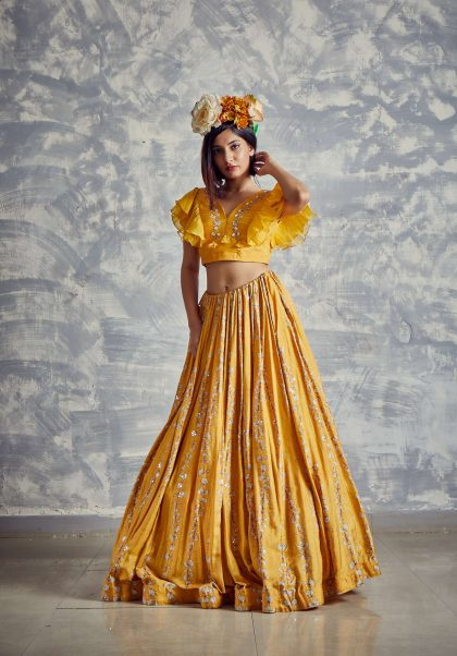 Gold finch printed lehenga set with hand embroidery and frilly organza sleeve