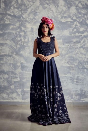 Navy blue printed long dress with small mirror work torso. Crafted in satin weave in natural fibre