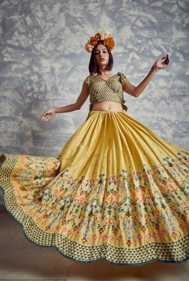 Citrine yellow Printed Tussar lehenga with scallops and printed overlap side tie-up crop top with delicate handwork and organza dupatta