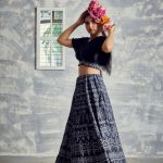 charcoal flared & printed lehenga with delicate motifs and hand embroidered wrapped Tussar crop top