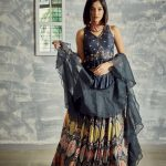 Charcoal printed flared lehenga with delicate embroidered crop top crafted in natural fibre Tussar & ruffled organza dupatta