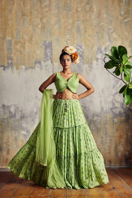 Lime green flowy chiffon skirt in tiny floral print with sassy top embellished with delicate mirror work all over