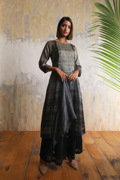 Charcoal grey geometric printed long tunic in Tussar with all over delicate hand embroidery teamed with Charcoal Linen satin flared pantsCharcoal grey geometric printed long tunic in Tussar with all over delicate hand embroidery teamed with Charcoal Linen satin flared pants