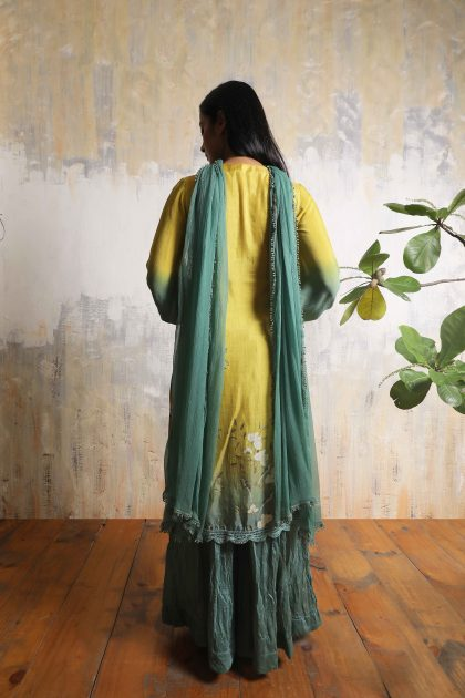 Corn yellow mid-length printed kurti in Tussar with Chiffon balloon sleeves and Chiffon lace dupatta and intricate handwork on yoke teamed with Teal green Chanderi crushed pallazosCorn yellow mid-length printed kurti in Tussar with Chiffon balloon sleeves and Chiffon lace dupatta and intricate handwork on yoke teamed with Teal green Chanderi crushed pallazos