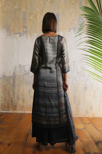 Charcoal grey geometric printed long tunic in Tussar with all over delicate hand embroidery teamed with Charcoal Linen satin flared pants