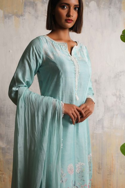 Mint blue printed long kurta in Linen satin with highlighted hand work teamed with Chiffon lace dupatta and Linen satin pants