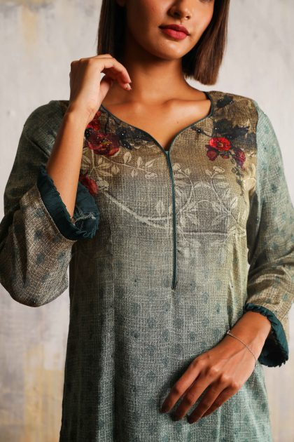 Teal green long printed A-line dress in Tussar with beautiful delicate hand embroidery neckline teamed with Bottle green Linen satin flared pants