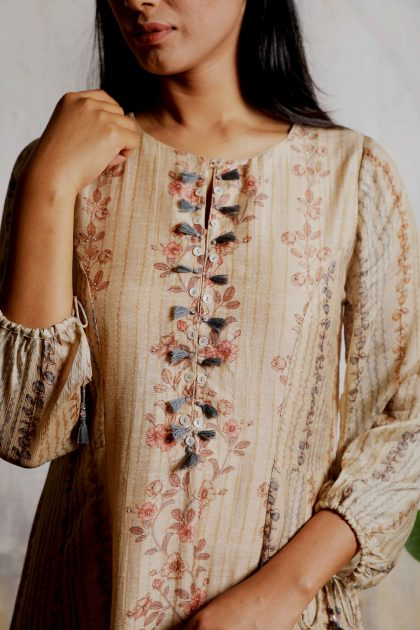 Beige printed A-line long dress in Linen with Chiffon tassels balloon sleeves and beautifully detailed handwork