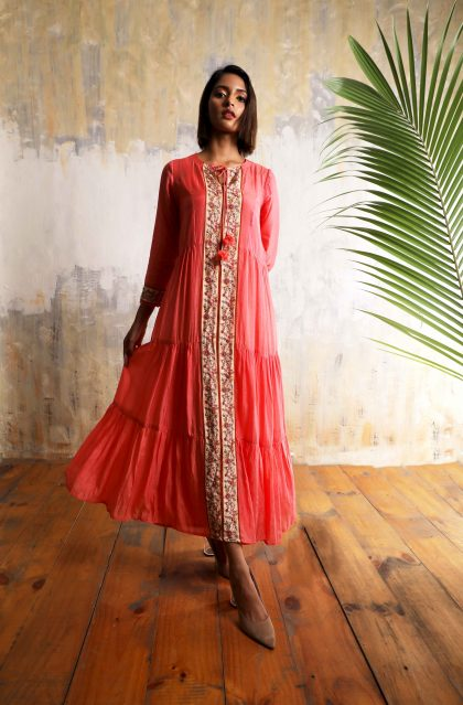 Desire pink tiered and flowy long dress in Cotton Silk with beautiful print and hand embroidered front line with tassel tie-up