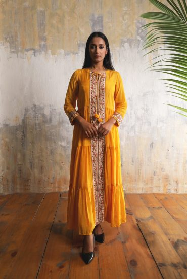 Gold tiered and flowy long dress in Cotton Silk with beautiful print and hand embroidered front line with tassel tie-up