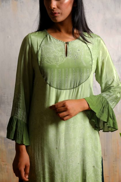 Olive green bandhani printed long tunic in crepe with delicate highlighted work on the yoke which can paired with pallazos