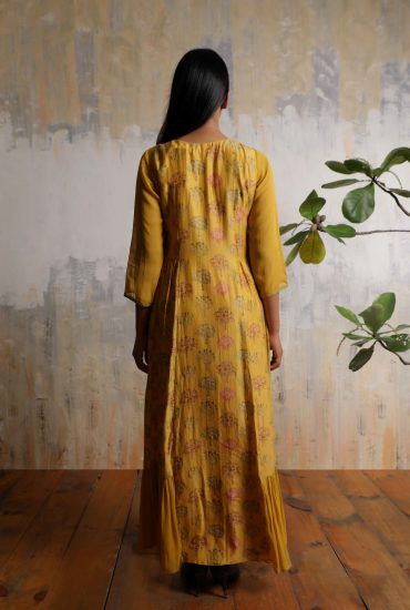 Mustard yellow printed long dress in Tussar with intricate embroidered yoke and front tie-up with tassels