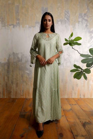 Sea green printed A-line long dress in Tussar with beautiful hand embroidered neckline and tassel statement sleeves.