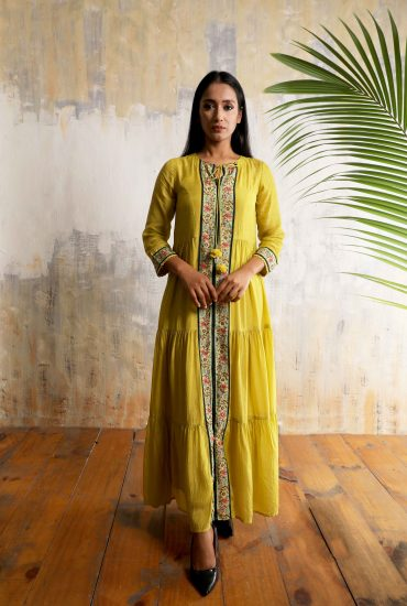 Lime green tiered and flowy long dress in Cotton Silk with beautiful print and hand embroidered front line with tassel tie-up