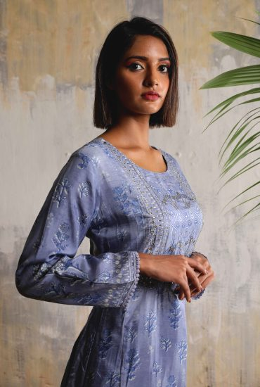 Crayola blue Tussar printed long tunic with beautiful gota patti work on yoke teamed with linen satin flared pants