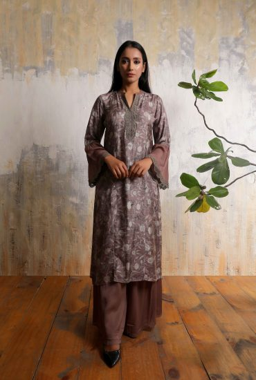 Chocolate brown printed long tunic in Tussar with all over handwork and statement sleeves teamed with linen satin flared pants