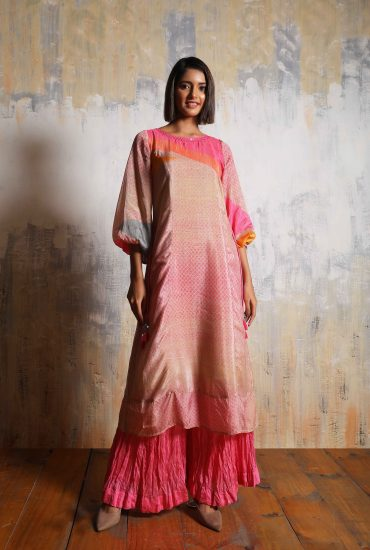 Artistic pink Crepe long tunic with detail hand embroidered neckline and balloon sleeves paired with Pink crushed Chanderi pants